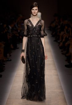 The dress at the top (by McQueen) is an hourglass silhouetted, white dress with an amazingly intricate black lace decorative layer. This dress is extremely simple but effective. The incredible use ...