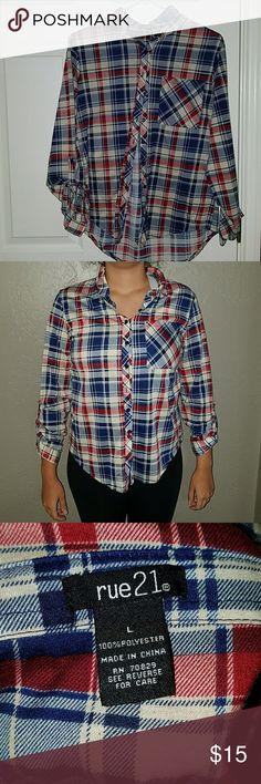 Long sleeved flannel shirt Cute and comfy long sleeved flannel shirt. Mix of blue,  red, and creme colors. You can where it with pants, shirts, leggings, buttoned up or open!! Offers accepted!! Rue 21 Tops