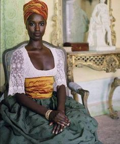 Beautiful dark chocolate skin!! And what can I say about the head wrap? Need to start experimenting.