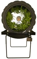 A novel way of hydroponic growing from OmegaGarden.com . A light fixture placed in the center of a rotating cylinder supports quite a few plants.