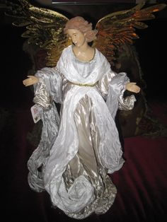 "Fabulous Angel 19.5"" tall dressed in flowing silky fabric gown. Gold wings. Very elegant. $65.00"