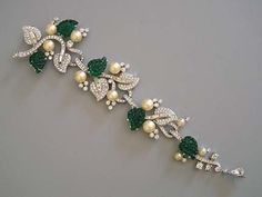 Mazer Brooch, jointed in three places...faux pearls, rhinestones and green art glass