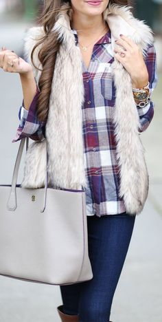 Wear a light fur vest over a colorful plaid shirt to brighten up dull winter style.