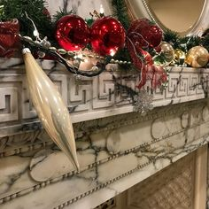 Mid century marble fireplace all decked out for the season @southbridgehcc . . . . #newenglandhotel #holidaydecor #christmasdecorations #newenglandstyle #christmas