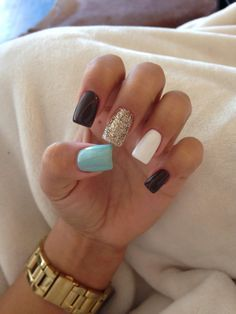 Glitter gold nail, white nail, light blue nail, and black nails