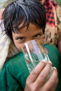 Clean water in Bangladesh from a charity: water pond sand filter.