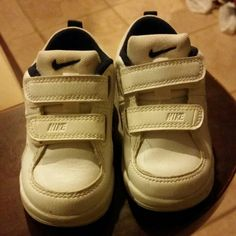 Nike toddler shoes Nike toddler shoes in white used, but not really worn just a lil flaw like the color, but I will clean it before sending it and open for bundles...  nike Shoes Sneakers