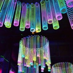 Slinkies definitely made a comeback at our event - Diy Event Glow In Dark Party, Glow Stick Party, Glow Sticks, Disco Party, Disco Theme Parties, Diy Birthday Decorations, Glow Party Decorations, Halloween Decorations, Table Decorations