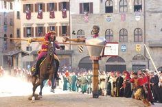"Joust of the Saracen ( Giostra del Saracino ) held twice a year in Arezzo, Tuscany. In this joust, ""knights"" on horseback representing different areas of the town charge at a wooden target attached to a carving of a Saracen king and score points according to accuracy. http://www.arezzo-info.com"