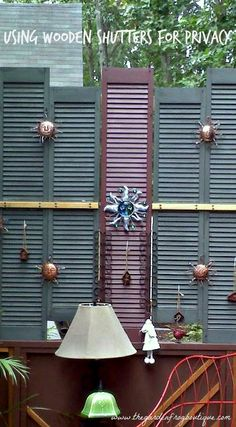 Using wood shutters to create privacy while the evergreens were growing to create privacy from the neighbors
