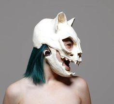 This is a urethane rubber cat skull mask. Its soft and flexible yet rigid enough to give the illusion of a skull. The jaw moves with the