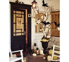 Diy Halloween Porch Decorating Ideas With Scary Halloween Tree And Faux Crow Ornament Plus White Wooden Stained Chair Together With White Stained Pumpkin Ornament And Also Antique Glass Lantern Diy Halloween, Halloween Veranda, Halloween Trees, Outdoor Halloween, Holidays Halloween, Happy Halloween, Halloween Decorations, Halloween Entryway, Classy Halloween