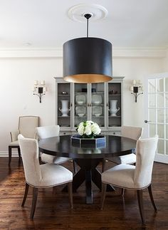 Sophisticated Elegant Chic Dining Room - Black Lamp Chandelier - Circle Wood Table - White Hydrangeas