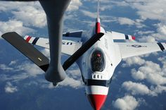 An F-16 Fighting Falcon with the U.S. Air Force Aerial Demonstration Squadron Thunderbirds lines up to receive fuel from a 92nd Air Refueling Wing KC-135 Stratotanker over Glacier National Park, Montana, Sept. 1, 2014. The Thunderbirds performed in Kalispell, Montana, hosted by the 2014 Mountain Madness Airshow Aug. 31, 2014. (U.S. Air Force photo/Airman 1st Class Janelle Patiño)