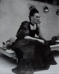 Alvarez Bravo, Lola:  Frida Kahlo Seated With Izcuitli Dogs, 1943, Printed 1980.