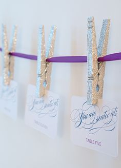 Use decorated clothespins to hang escort cards (or well-wishes) to colorful cord/ribbon.