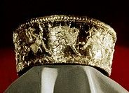 Scythian calathos headdress, from Boliznitsa, southern Russia, 6th-4th century BC. A calathos headdress made of thirty pieces of joined gold inlaid with blue enamel on the lower edge. The relief design depicts barbarians (Arimaspi) fighting griffins. Each figure is a separate piece and is attached to the background with pins