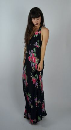Stunning 1990s floral gown. Made in a black rayon with a gorgeous bold floral…