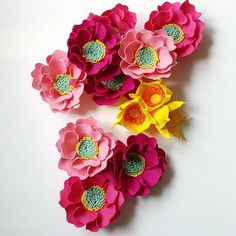 Pink, hot pink and magenta peonies will soon be put together into one beautiful custom baby mobile