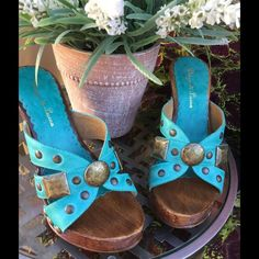 """ONE OF A KIND 🌸 GORGEOUS Leather and wood wedge shoes. The front is a 1"""" platform and the back is 4.5"""" wedge height. The leather is a stunning teal blue adorned with bronze nail heads & The grain of the wood is visible in these beauties!  Condition - like new🎀 Shoes Wedges"""