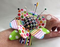 Fun and funky wrist pincushion by mamacjt, via Flickr