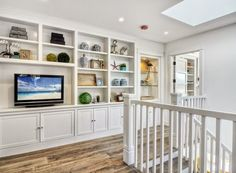 recreate this look with upper kitchen cabinets attached to lower wall and shelves built above. trim out & you're done!