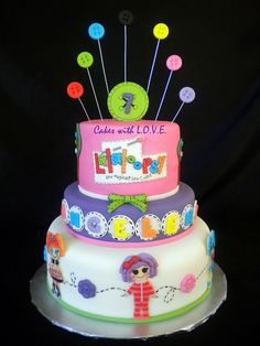 "I like the idea of having several lalaloopsy dolls on cake since i dont know her favorite.   buttons just scream ""make out of fondant"" to me.."