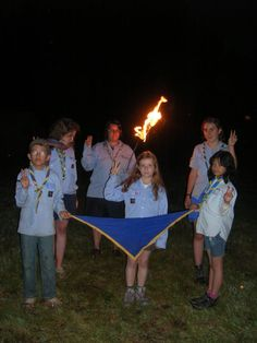 A new cub makes her promise for the EEUdF (France's  Protestant Co-educational Scout/Guide association).