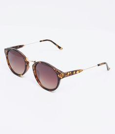 4739a5f230b8b Óculos de sol Modelo redondo Hastes em acetato Lentes marrom degradê Proteção  contra raios UVA