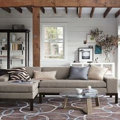 Sectional. Creams, blues, browns, wood, glass