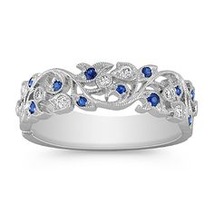 This beautiful, vintage inspired ring features 12 round and colorful, pavé set sapphires, at approximately .16 carat TW, and nine round pavé set diamonds, at approximately .10 carat TW . Hand-matched for maximum color and clarity, these gems are set in a lavish 14 karat white gold setting with milgrain details  The total gem weight is approximately .26 carat.