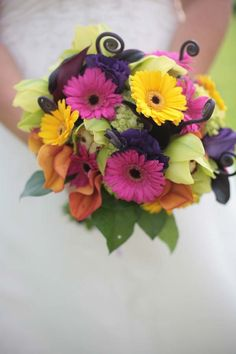 gerbera daisies, bright wedding flowers, wedding flowers, unique wedding flowers, yellow and pink gerbs, orchids