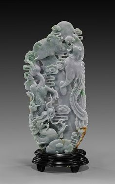 """Chinese Carved Jadeite Dragon  Phoenix Group Tall Chinese openwork carved jadeite group; of vertical composition and depicting a dragon and phoenix with ruyi scepter; in lavender with light apple green and russet color suffusion; H: 12 1/2"""", wood stand"""