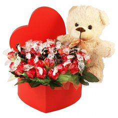 One of our best sellers loves gift, either for Valentine's Day or just to show how much he / she loves you.  A classic arrangement of 75 pralines of chocolate modeled as red roses set in a heart-shaped red box.  With a comfortable 20 cm soft teddy bear, this perfect bouquet design comes together.  A suitable gift for Valentine's Day gift that will melt the heart of your special friend as they will receive this wonderful sweet bouquet gift! #ValentinesDay #ValentinesDayGifts Chocolate Roses, Chocolate Bouquet, Valentine Day Gifts, Valentines, Corporate Gifts, Love Gifts, Red Roses, Christmas Wreaths, Teddy Bear