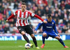 Connor Wickham of Sunderland shields the ball from Gary Medel of Cardiff City during the Barclays Premier League match between Sunderland an...