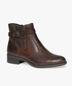Boots unies dessus cuir