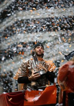 Giants pitcher Madison Bumgarner holds his MVP trophy during the World Series Parade in downtown San Francisco, Calif., Friday, Oct. 31, 2014. The San Francisco Giants enjoyed the spoils of victory with their fans as they participated in their third World Series victory parade in five years. (Patrick Tehan/Bay Area News Group)