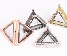 Rhinestone embellished triangle locketComes with matching chainMade of alloy
