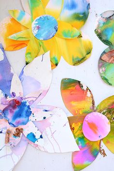 Kids do watercolor on paper, then adults cut it into flower shapes and assemble flowers