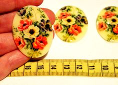 more lovelies for holiday jewelry crafting.  Grab some of these lovely floral glass cabochons, and a setting from my shop, a little glue and POW you have a great gift that is one of a  kind, ecofriendly AND incredibly stylish.  Yay you!!  Cabochon  4 Rare Vintage Floral and Cream by bansheehouseofmake, $8.50