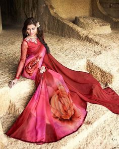 Get yourself look like a Diva in this impressive Red & Pink color printed Saree with Georgette fabric.