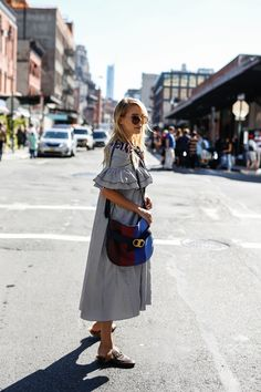 Leonie Hanne of Ohh Couture with the Gemini Link Shoulder Bag in NYC