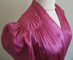 love the shoulder detail and the raspberry color of this 1940s satin dressing gown
