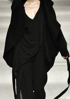 Designer Unknown - This garment (and entire look in fact) has taken the initial idea of the blazer and essentially loosened it up and transformed it into a rather oversized, voluminous piece that swathes the body. Simplistic yet effective.