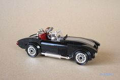 "On his Flickr photostream, _lichtblau_ posted three images and 4-page Building Instructions for his Lego AC Shelby Cobra car.  He wrote that ""The AC Shelby..."