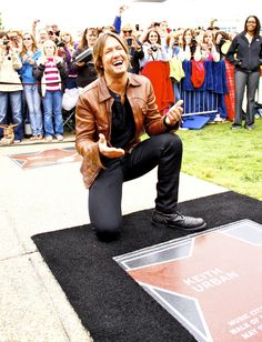 Keith Urban receiving a star on the Music City Walk Of Fame in Nashville, TN. Keith's wife Nicole Kidman was in attendance. Country Music legend Ronnie Milsap presented Keith with his star. Keith bent down to kiss his Star and then kissed Nicole. When fans yelled out for Nicole to kiss the star, Keith shouted 'Star, she's the star'