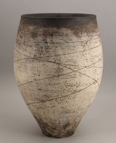 Hans Coper | Early vessel, c.1953.  Layered white slips rubbed with manganese, the body with incised linear designs.