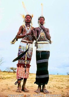 Wodaabe (Bororo/Fulani) men dressed and decorated for the Gerewol dance, which is at once a male beauty contest between competing clans. African Masks, African Art, Fulani People, Desert Sahara, Africa People, Beauty Contest, March 6, African Tribes, Crazy People