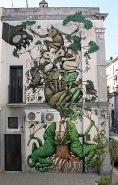 The awesome work ofEricailcaneon a wall in Italy for the 2011FAME Festival.