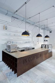 The Interior Design Institute  For all the coffee lovers out there! At Bistro Proti Proudu in Karlin, Czech Republic the cafe's motto, IN COFFEE WE TRUST, is boldly and prominently etched into the rusted steel counter for all to see. What do you think of this cafe?
